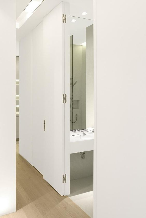 This door allows for 180 degree action, which in this case was required to offer the hall bathroom an outswing, while folding out of the way for someone passing by.