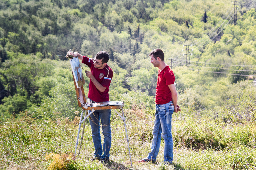 Two artists paint the surrounding scenery at Lake Sevan