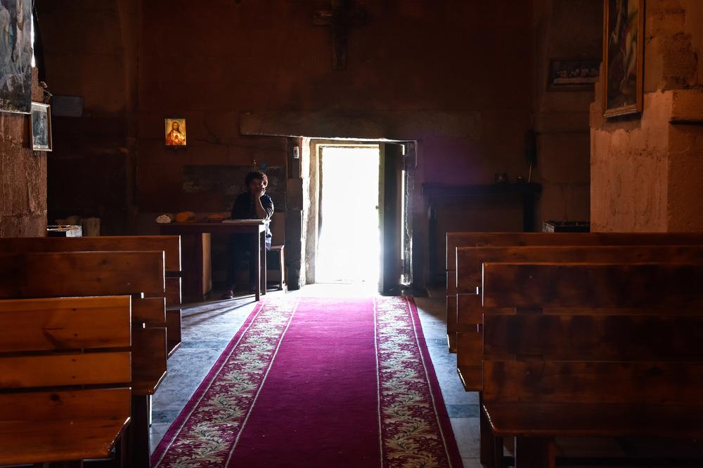 The caretaker at her desk inside the church