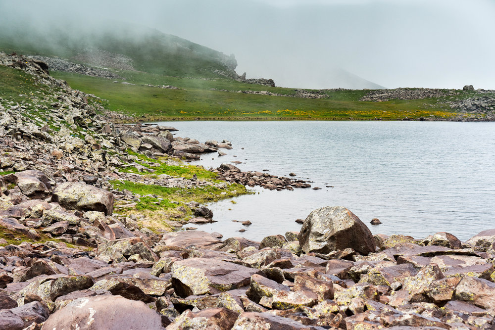 The talus field on the other shore where we began exploring