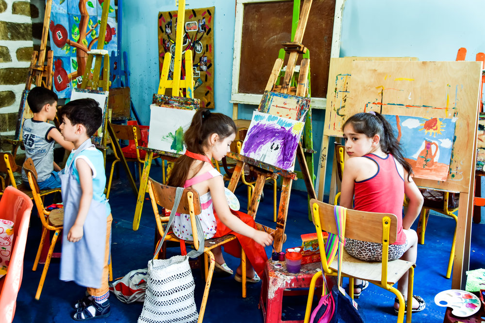 Young painters at work in the studio.