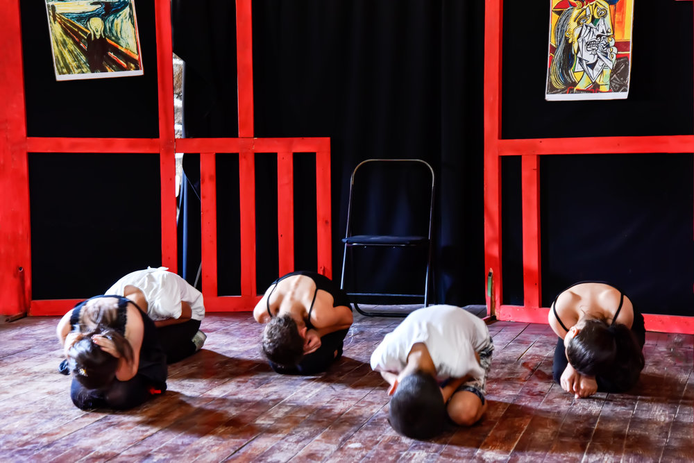 Kids in motion at a drama class in the small existing theater.