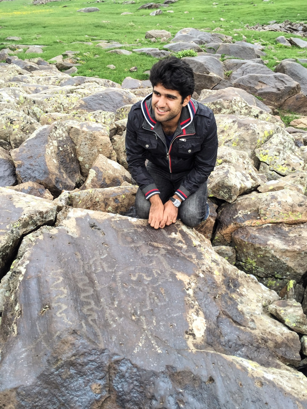 Hayk (our guide, translator, and dear friend) at the petroglyphs