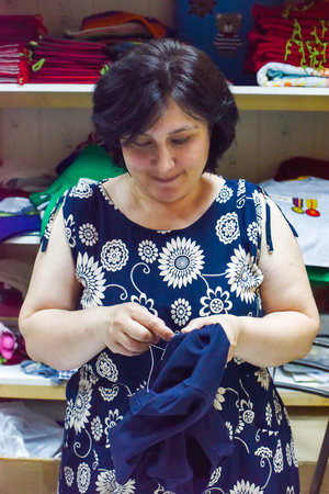 Skilled workers produce the beautifully detailed clothes by hand