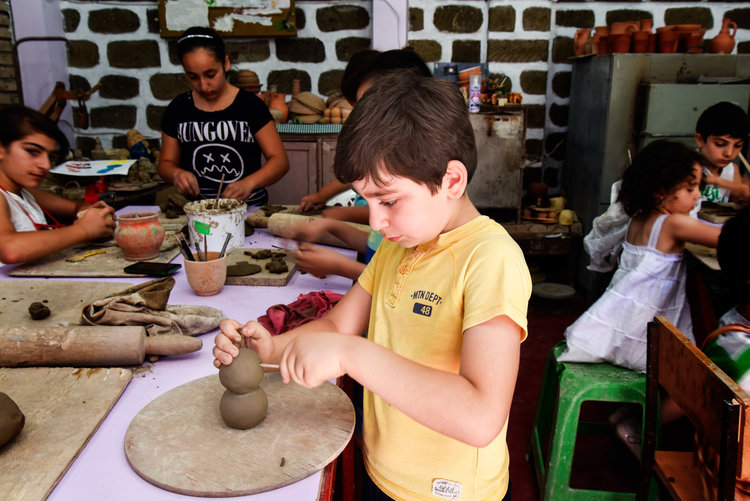 Pottery classes, where young artists make figures like the ones above.