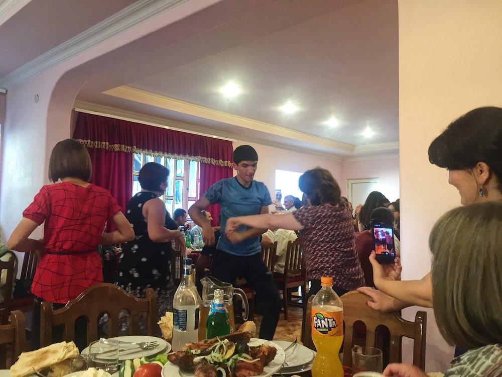 Hayk dances with the women