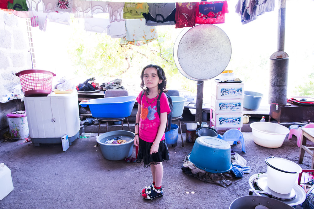 Angela's daughter Ani is ready for school in Movses village.