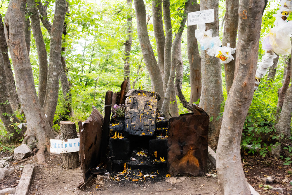 A Christian altar has been devised in a grove sacred since ancient times