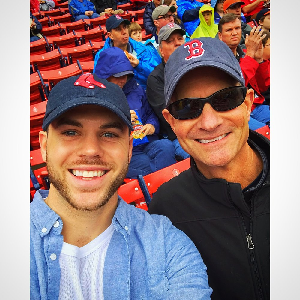 Patrick embracing local sports and culture at a Red Sox game with his dad.