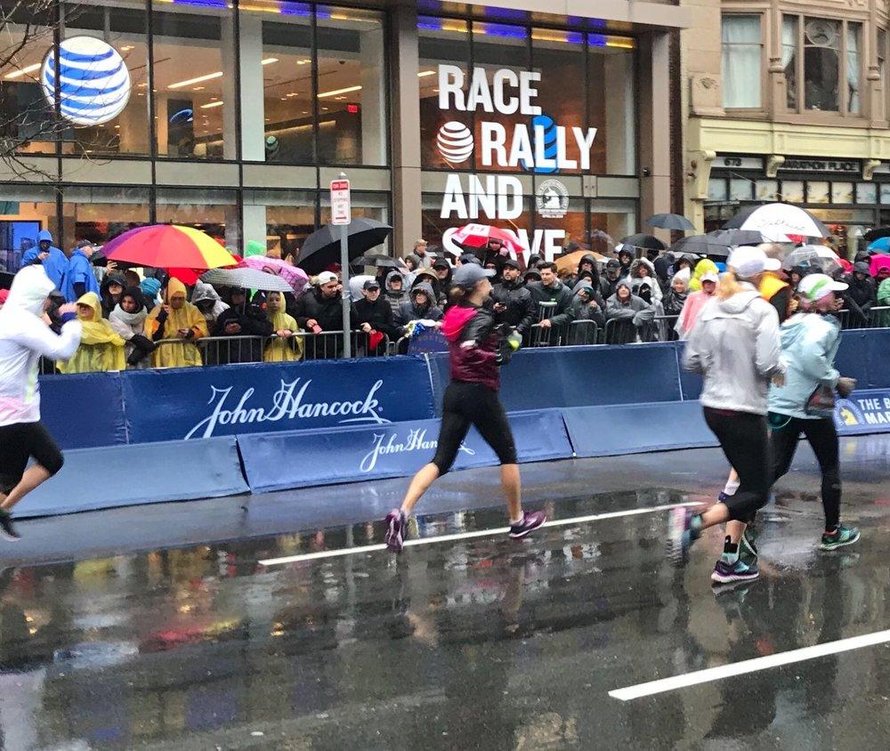 Running toward the finish line of a very rainy 2018 Boston Marathon