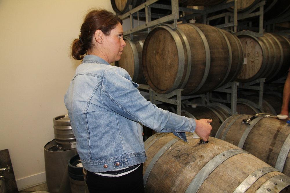 Preparing a barrel tasting.