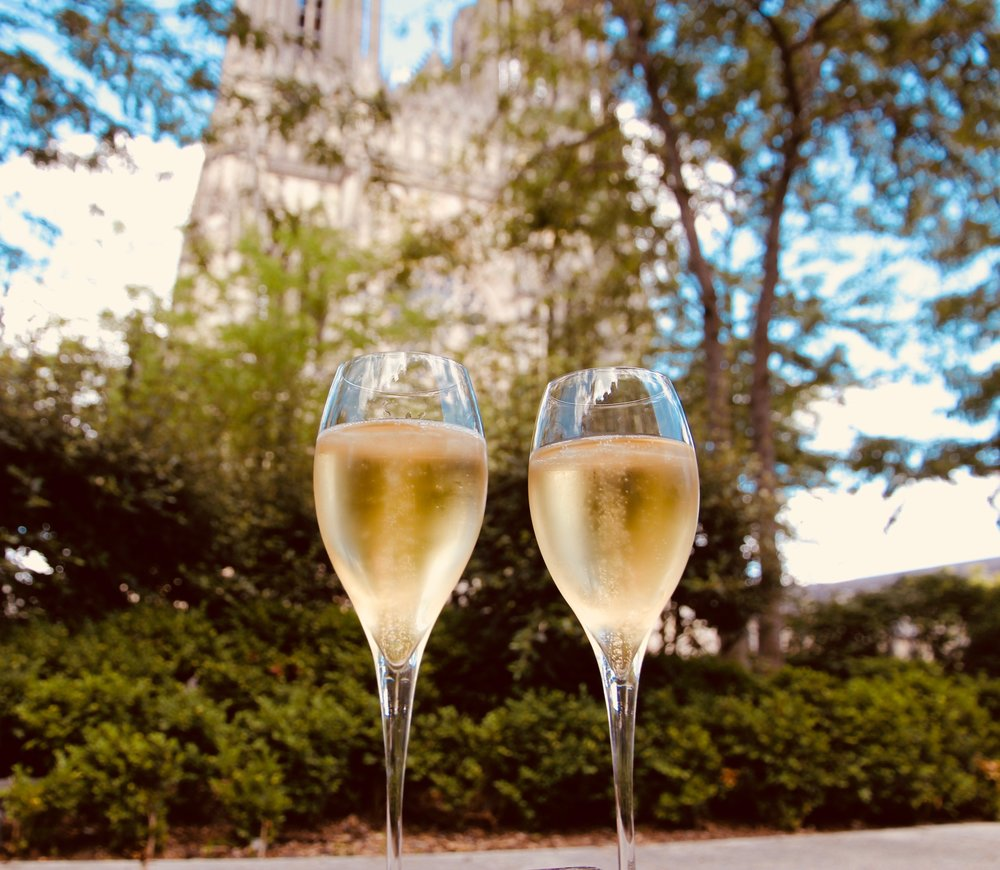 Champagne at the foot of Notre Dame de Remis.