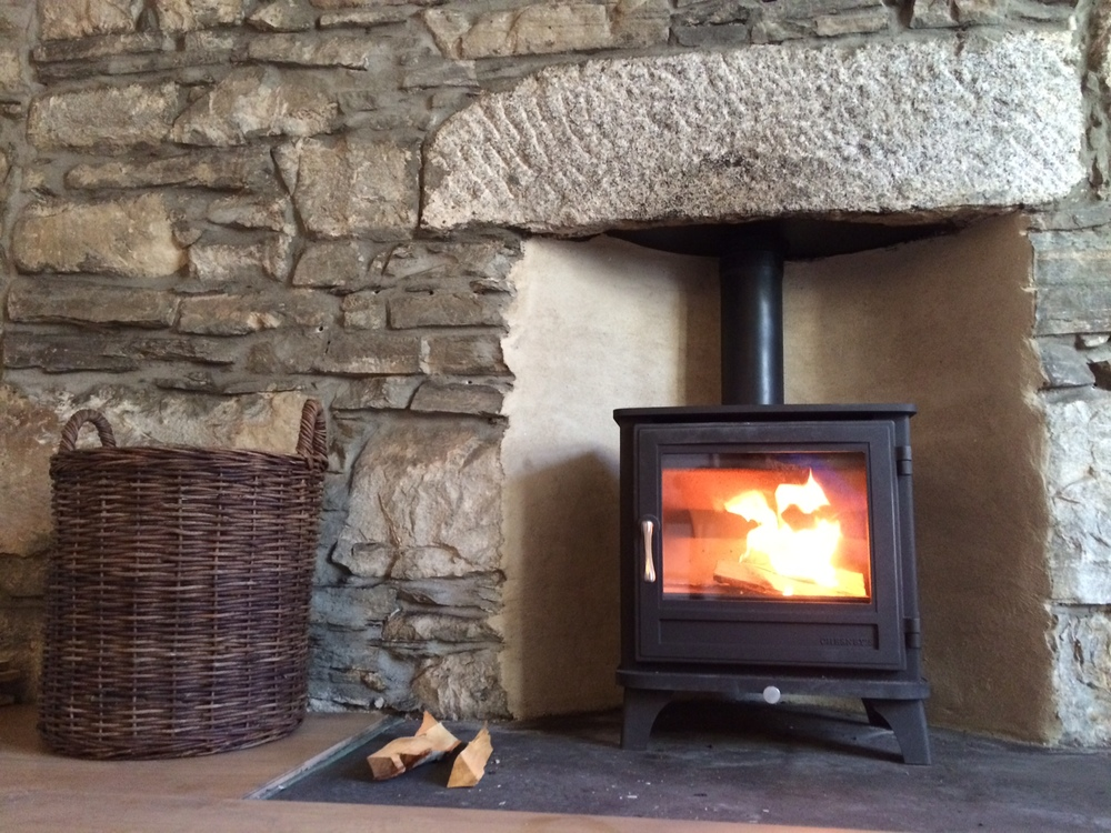 Log burning stove with wood/ kindling provided