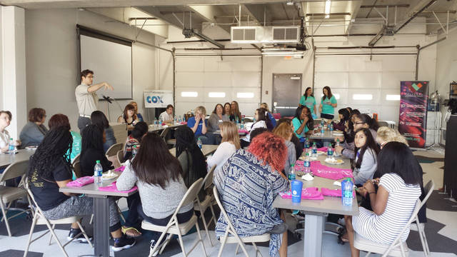 Girls learning about careers and local tech companies at Women in Tech event at StarSpace46