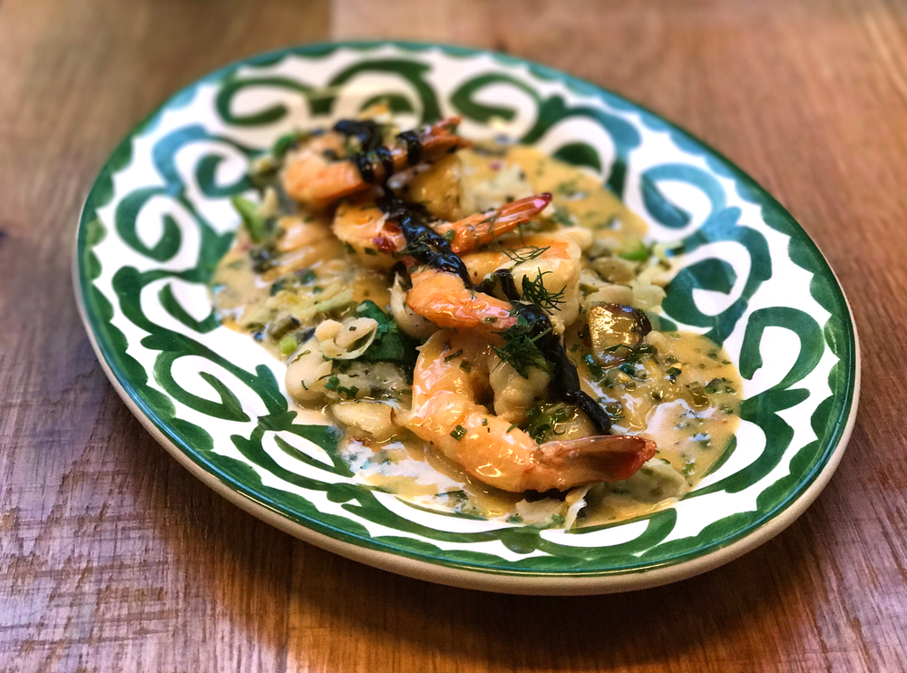 Shrimp Kastoria with gigandes, spinach, leeks, and black garlic.