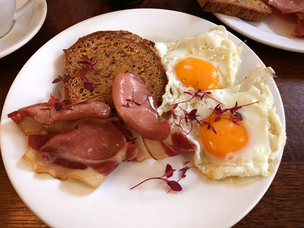 Fried eggs, bacon, and gluten-free nut and seed bread from Edinburgh Larder Cafe