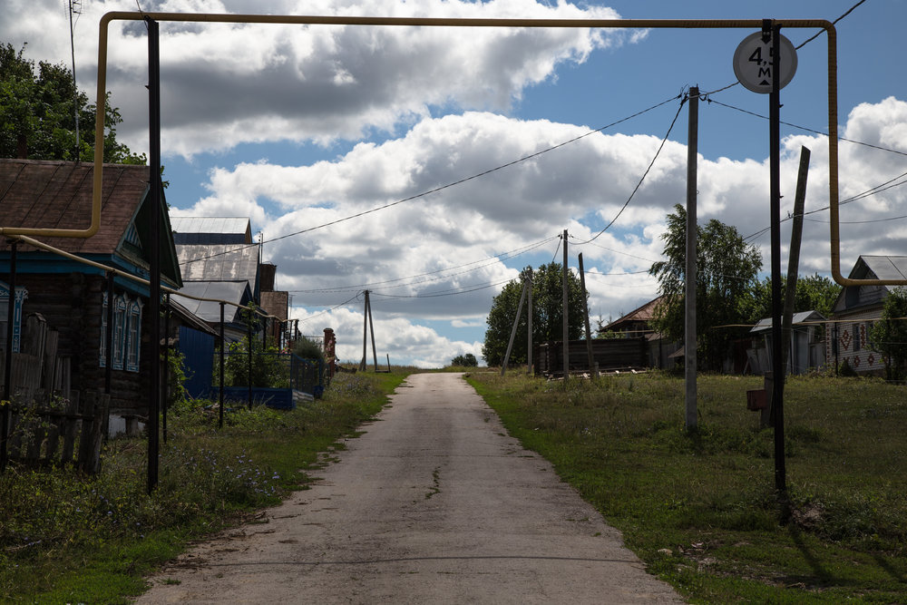 The only paved street in the village.