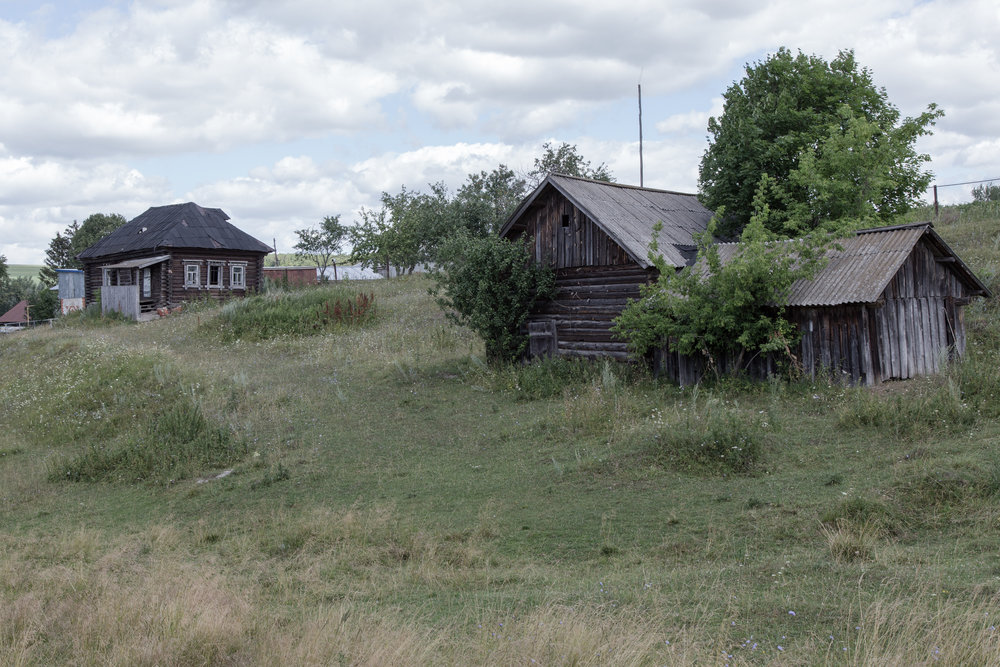 An old clubhouse (the building in the back) and a granary (building in the foreground).