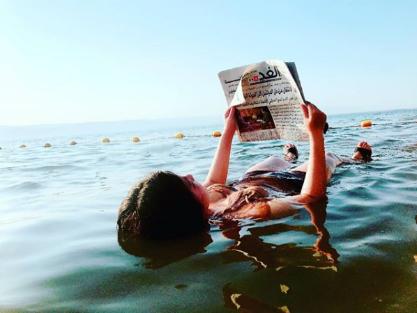 Relaxing in the Dead Sea. Photo taken by  @eldora0x0 on Instagram .