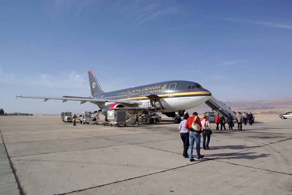 A Royal Jordanian plane at the airport in Aqaba. Photograph taken by Berthold Werner distributed under a  CC BY 3.0  license.