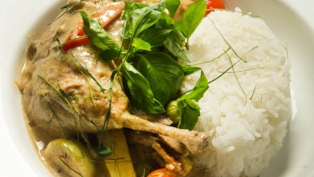 Slow-braised green curry duck leg. Photo: Simon Schluter