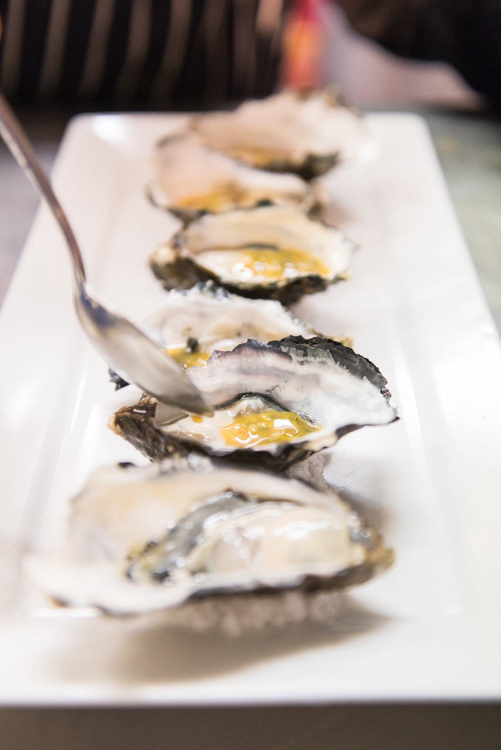 Our signature dressing or 'Nam Jim' passionfruit with fresh oysters
