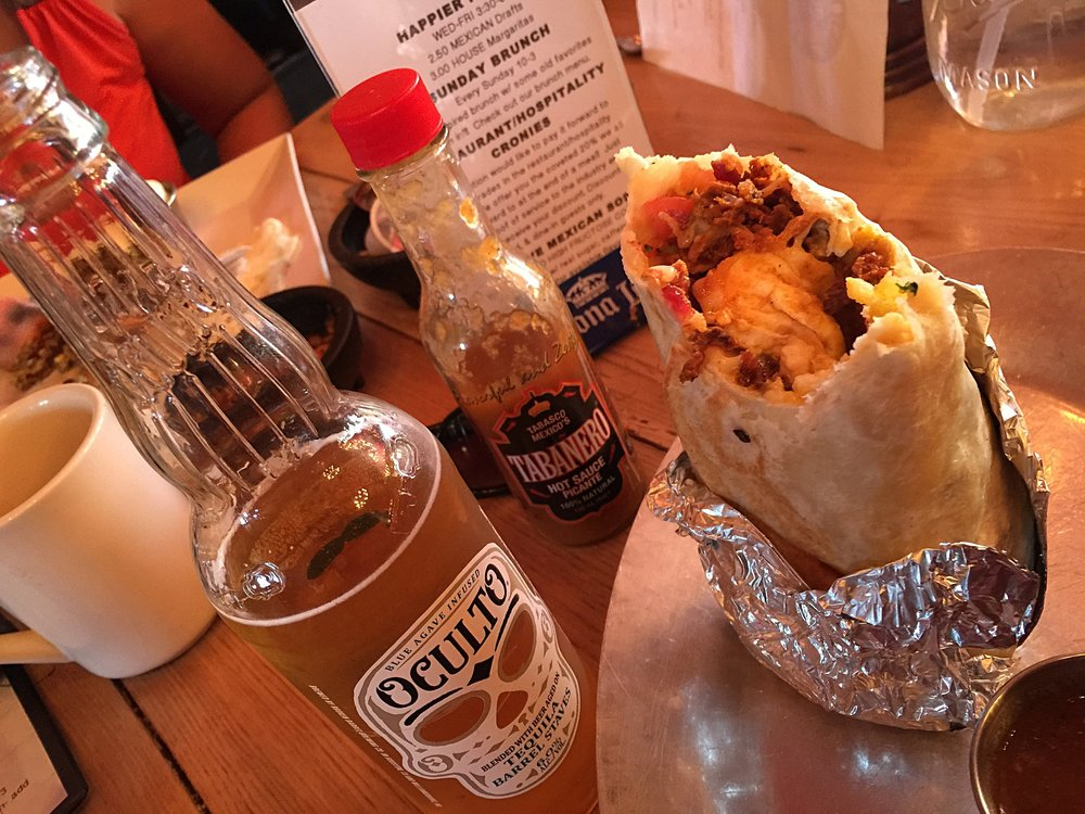 We refer to this as the perfect breakfast....California breakfast burrito, hot sauce and an ice cold beer.