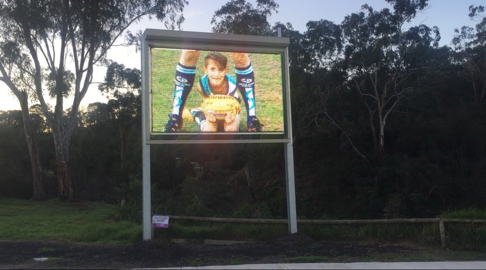 My son Taj on the new scoreboard at the St Mary's Junior Football Club celebrating Indigenous Round at a local level.