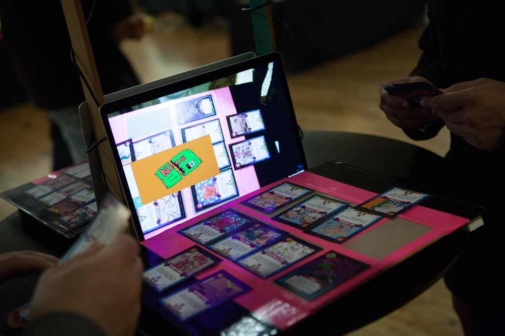 Augmented Reality - Show Show brings artists and technologists together to create augmented reality games for brands. Players draw cards and place them on camera-monitored platforms. Whenever three cards of a kind are placed in a row, a new video is unlocked and viewed by the players. These games can be downloaded on mobile devices and played anywhere.