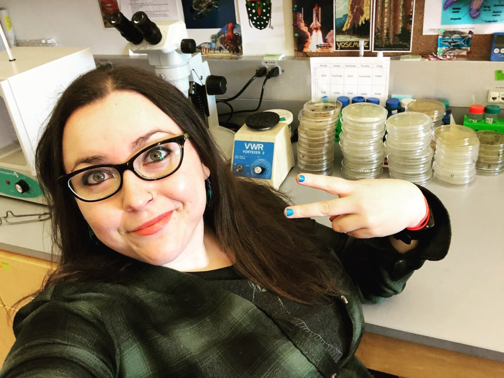 Sarah McAnulty   Say hello to my little friend: Beneficial relationships between bacteria and squid  Sarah McAnulty is a squid biologist at UConn studying how bobtail squid and their beneficial bioluminescent bacteria communicate!