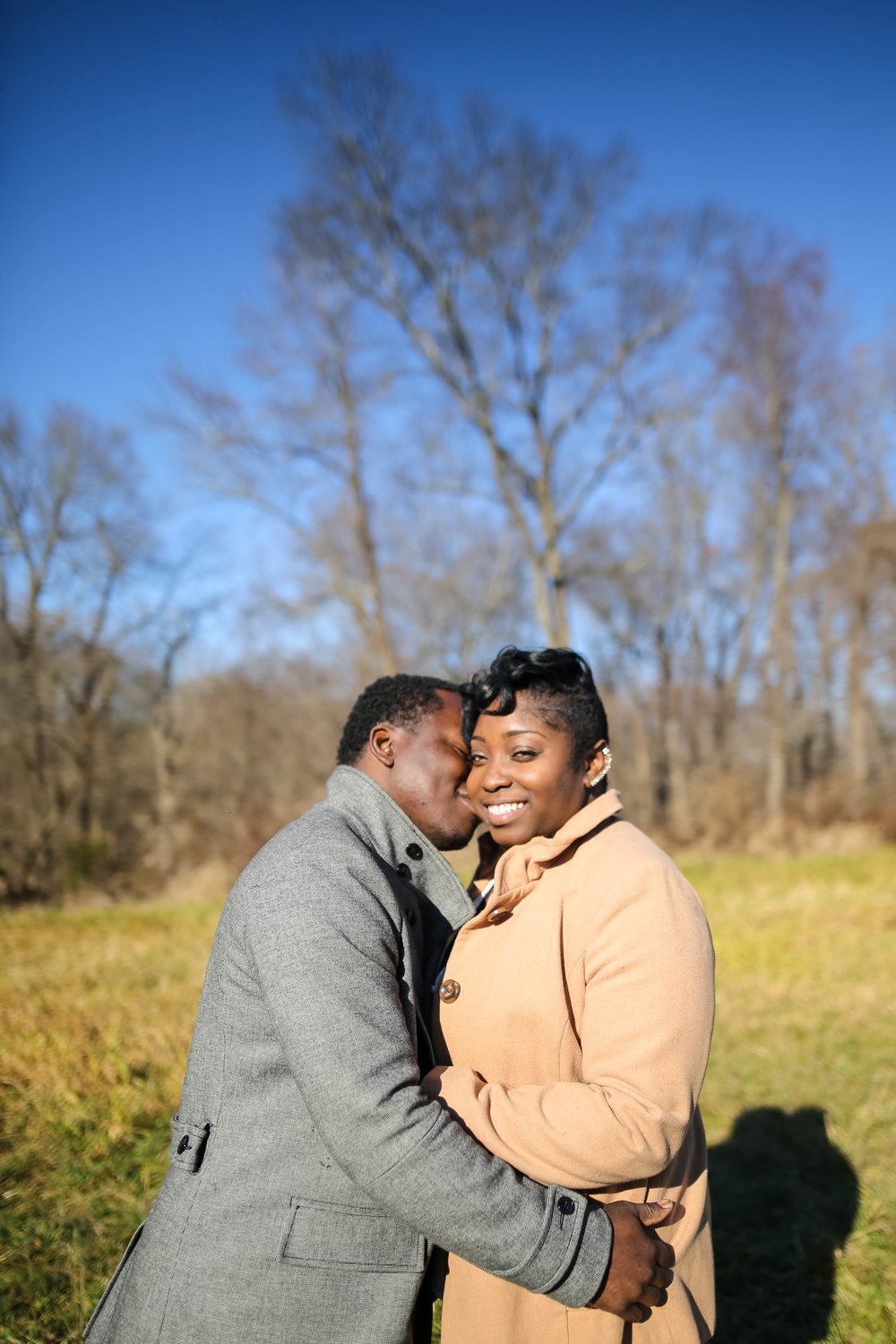 Ebony and Creig had no idea where to do their engagement session but they knew they wanted bright, winter photos!  I suggested Tyler Park and they LOVED the results!