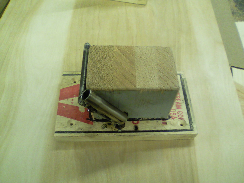Final product of arrow appearing device, only one more change was made during tech.  That was to angle the back of the block to make it safer for actor's feet.