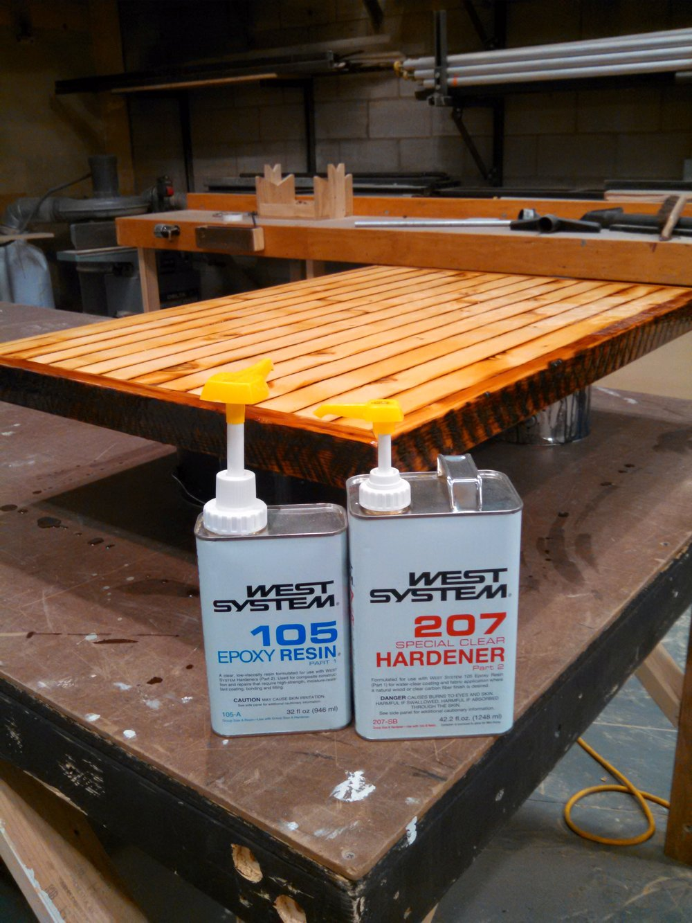 Footrest table top sealed with West System Epoxy.