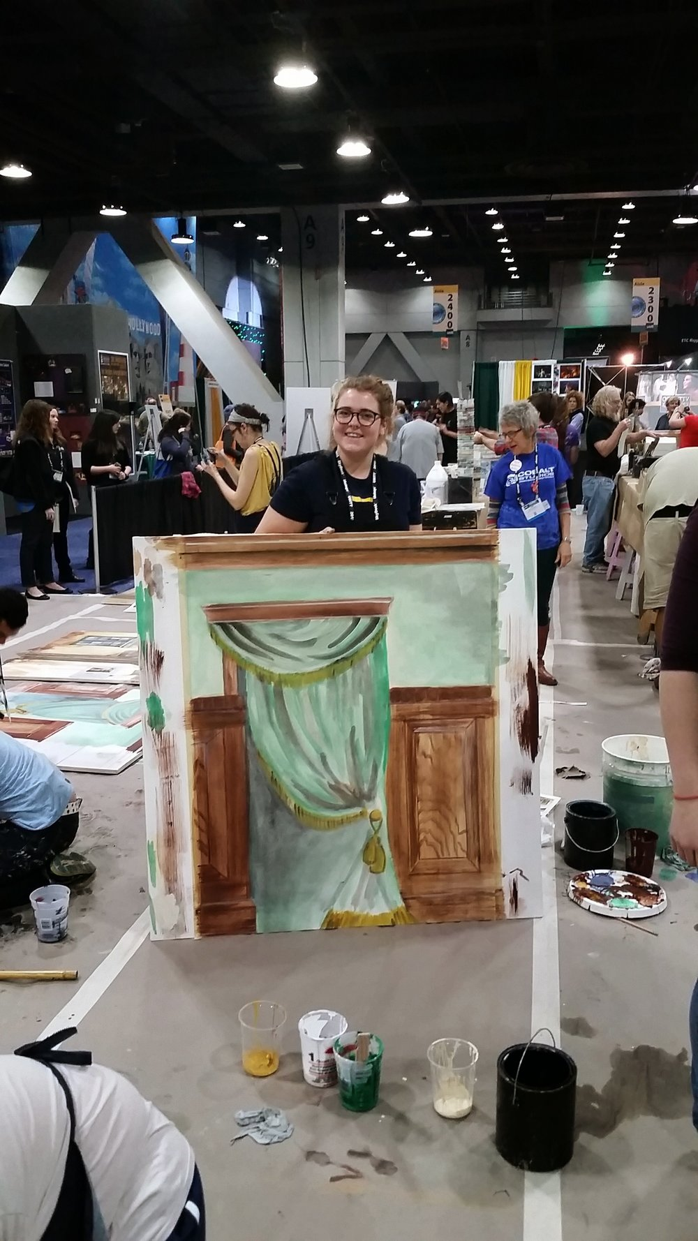 Becca Smith (2016) takes part in the scenic painting workshop at USITT 2015 Cincinnati.