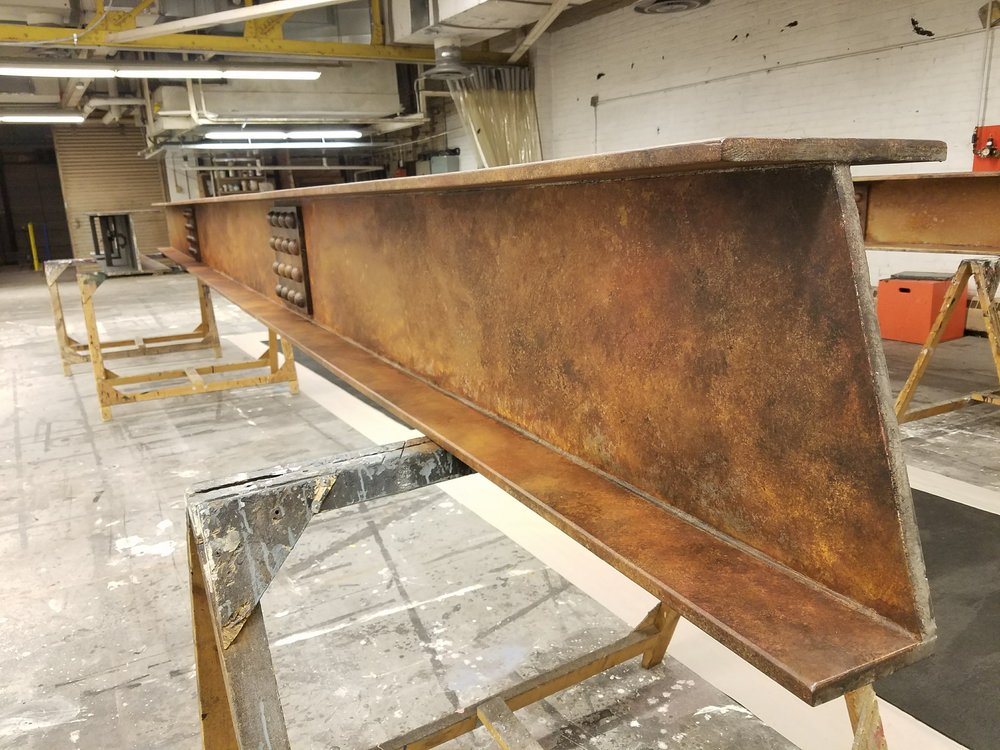 I-Beams were cut to custom angles where they would land on the raked deck