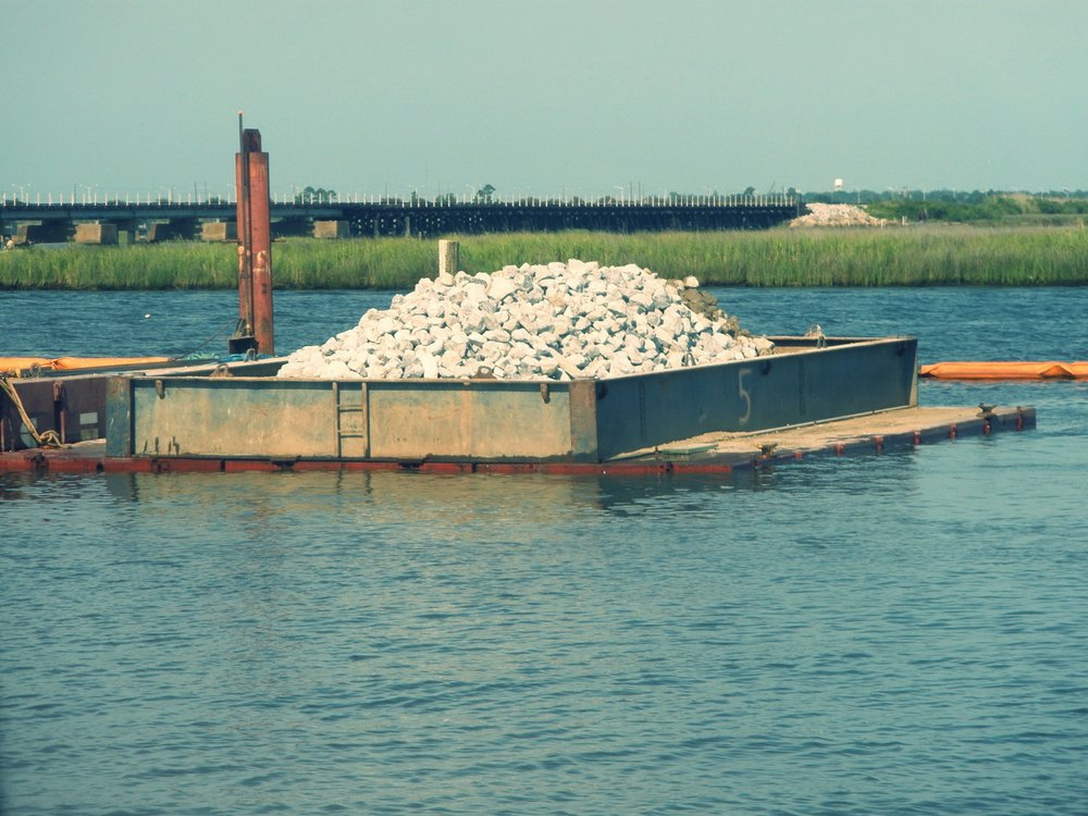 Cap materials if floating sectional barge