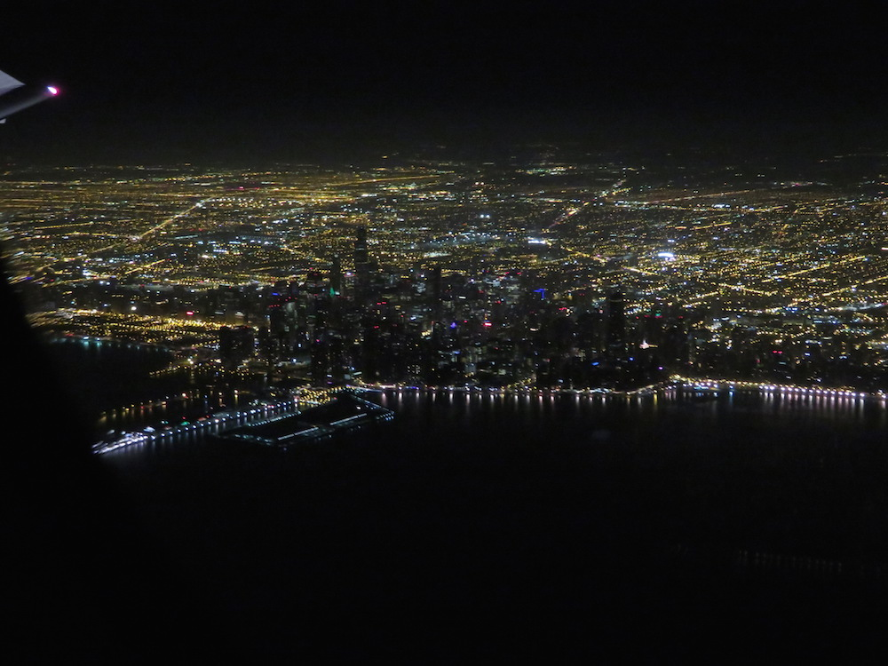 The view of Chicago from a plane at night