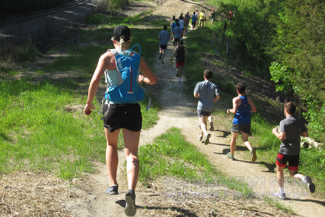 "Somebody running near me in the first few miles was carrying a camera and posted some pictures. There were a few of these ""runners choice"" hills when we first hit the trails - go straight over the hill for shorter distance, or around the side for longer distance. I chose the ""low road""."