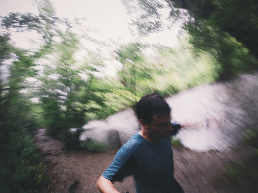 Digging in to some hard 1 mile trail repeats on an Friday evening in August, in a soaking rain, with the Olympics and takeout barbecue calling my name.