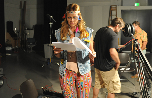 "Actor Audrey Walters studies her lines during the shoot of the comedic short ""Dysfunctional Dynamics."" (August 2013)"