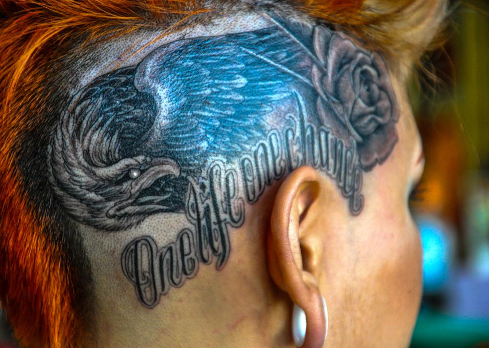 enrique ejay bernal eagle head tattoo.jpg