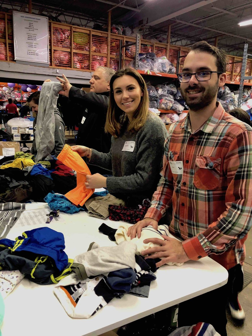 DrayNow team members Mike Albert, Stephanie Beyda, and Arthur Maull at Cradles to Crayons.