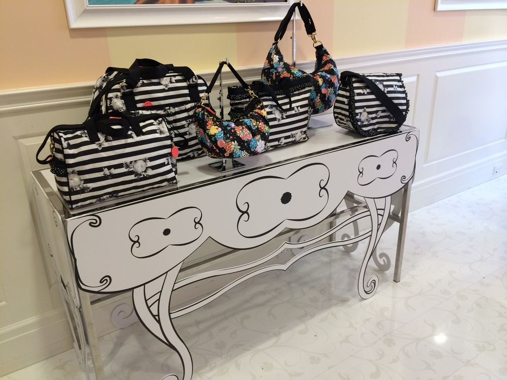 LeSportsac transforms a simple metal table into a POP that would make anyone take a second look.