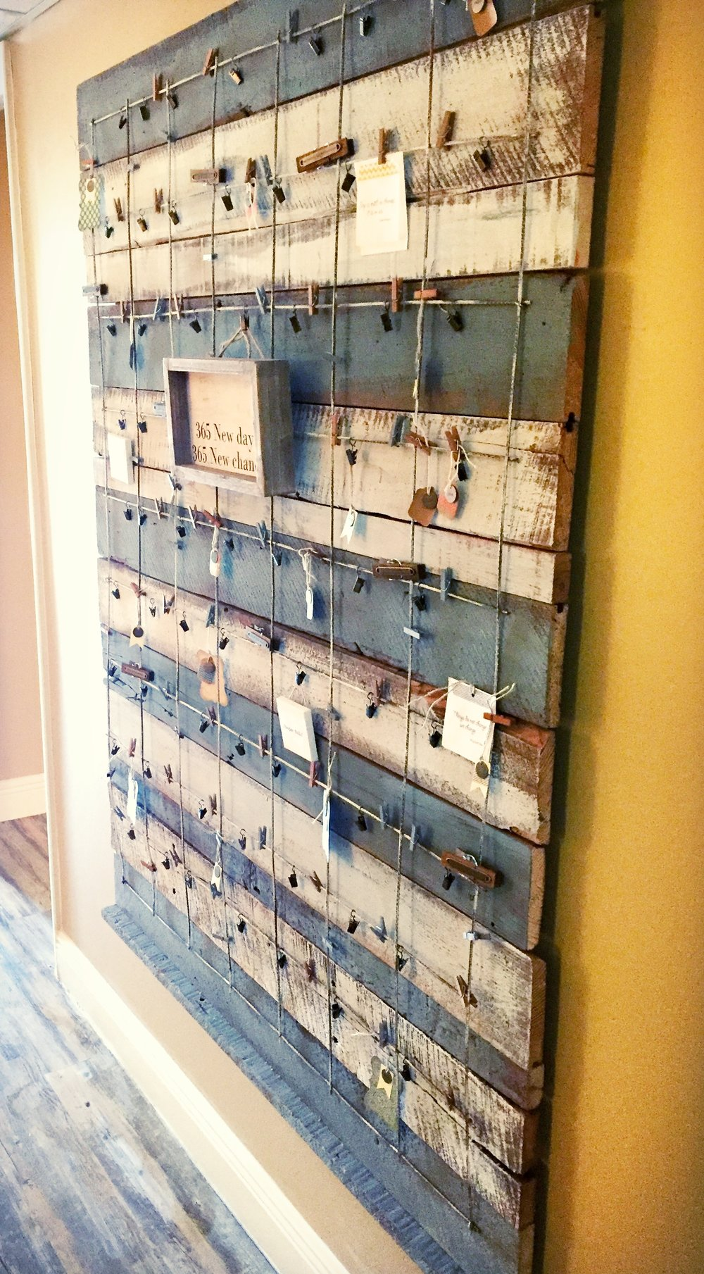 "The gratitude board now hangs in our hallway.  It's a new collective space for clients and families to ""post"" their gratitude photos or comments so we can all share in the positive experience of gratitude. Unique pieces of weathered, reclaimed wood were used to make the board."