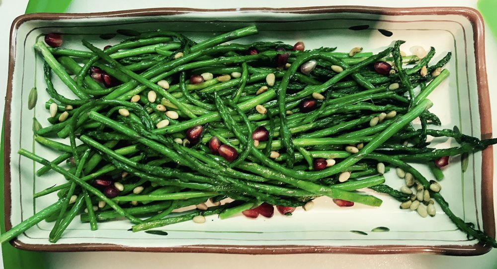 Roasted asparagus with pomegranates and pine nuts