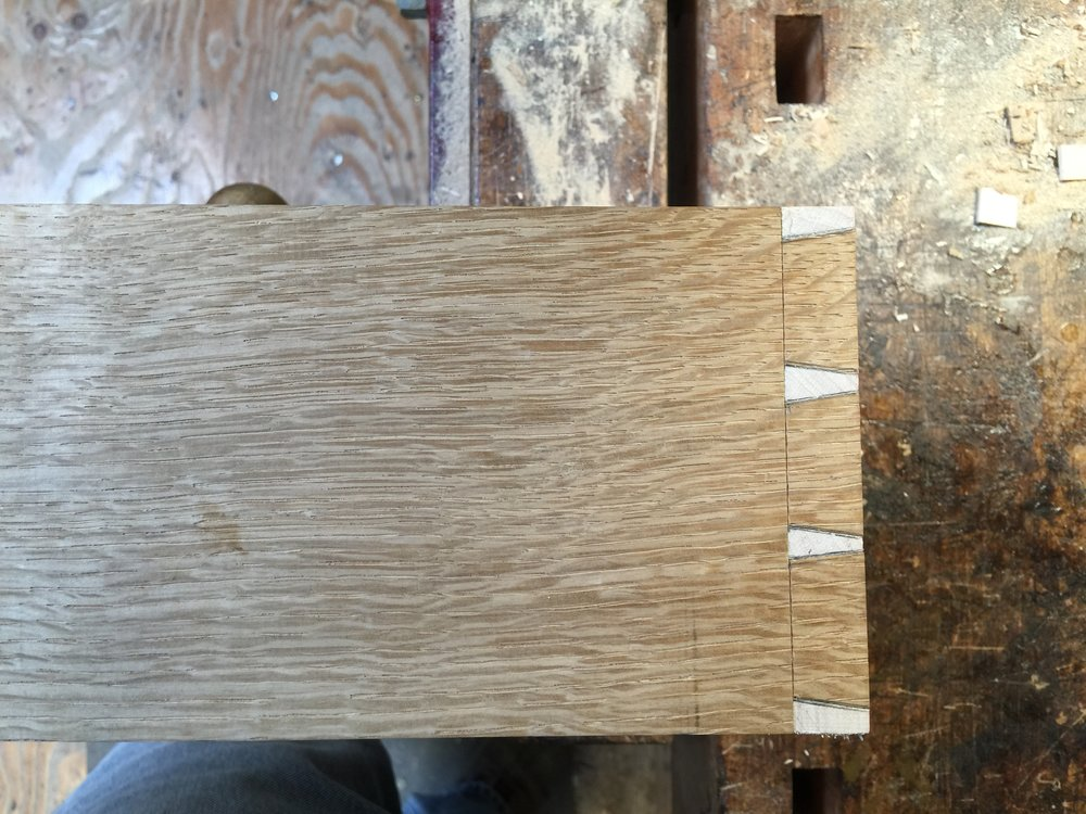Hand dovetailed oak drawer side and maple drawer front.