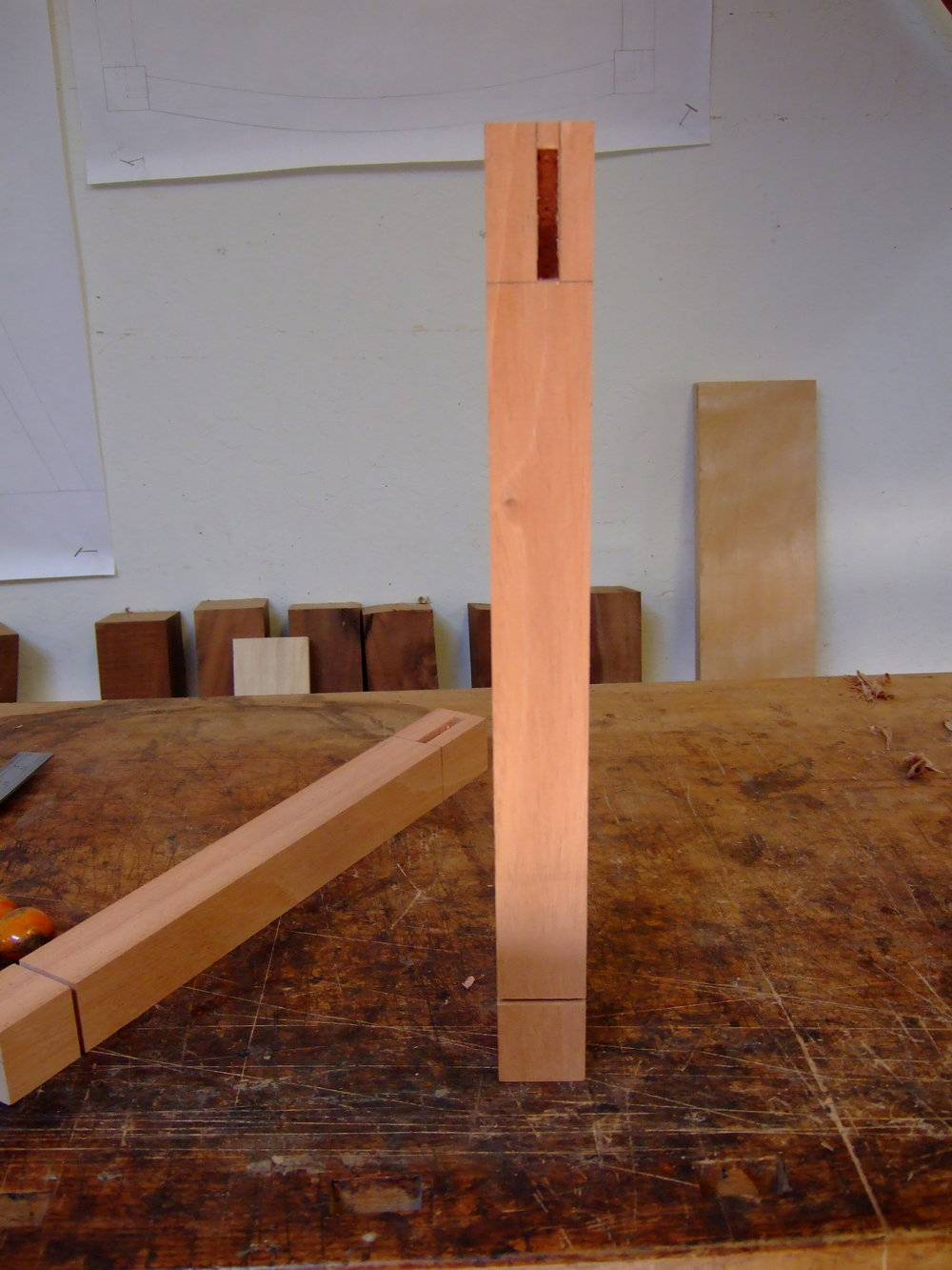 These are the front leg blanks with mortises cut and the depth cut for the fillet detail on the spade foot