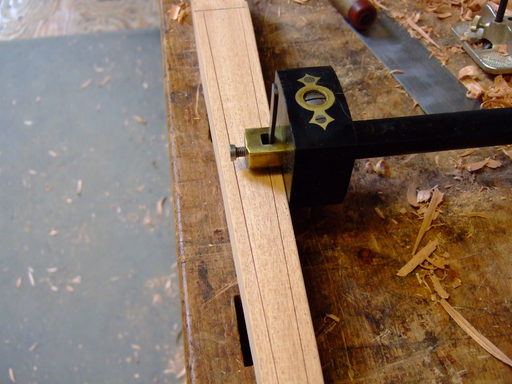 After tapering the legs I use a cutting guage to mark the recessed field of the legs.