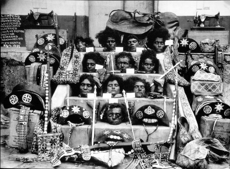 José Castro, Retratos do cangaço, Imagem oficial da degola do bando de Lampião,Autor Desconhecido, 1938.   Placements: Qualquer parte do corpo, desde que tenha tamanho apropriado e suficiente para que o tema possa ser satisfatoriamente explorado.