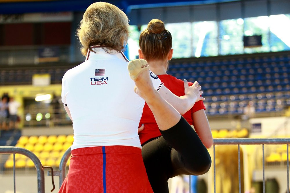 Gymnast being coached